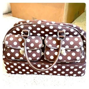 Small brown polka dot carry on